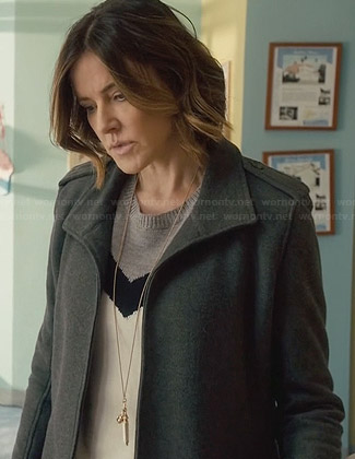 Ellie's tri-tone chevron sweater and grey coat on Cougar Town