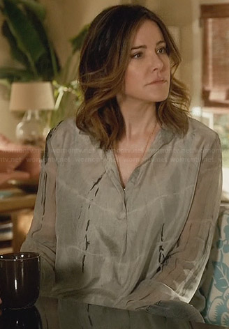Jules's blue spot printed wrap dress on Cougar Town