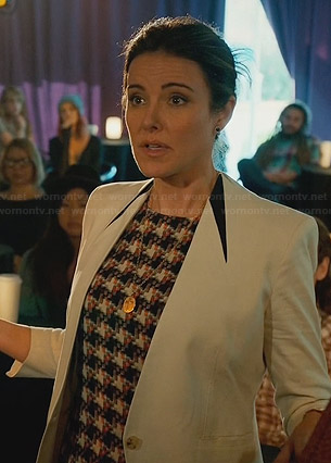 Ellie's white blazer with black leather insets on Cougar Town