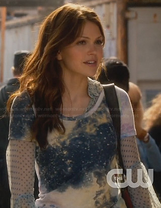 Emery's blue polka dot shirt and galaxy tee on Star-Crossed
