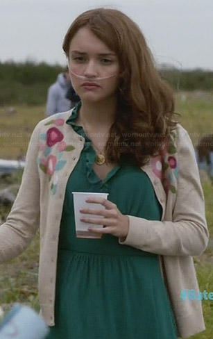 Emma's green ruffle front dress and floral cardigan on Bates Motel