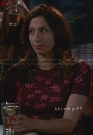 Gina's red dress with pink bug print on Brooklyn Nine-Nine