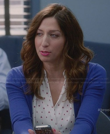 Gina's white printed v-neck blouse on Brooklyn Nine-Nine