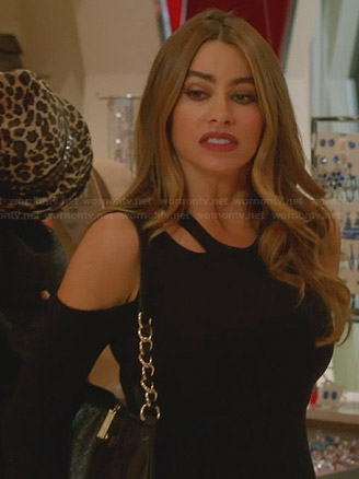 Gloria's black cutout top on Modern Family