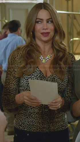 Gloria's leopard print cardigan and yellow crystal necklace on Modern Family