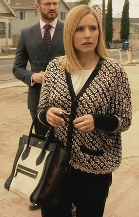 Jeannie's flower printed cardigan and black and white bag on House of Lies