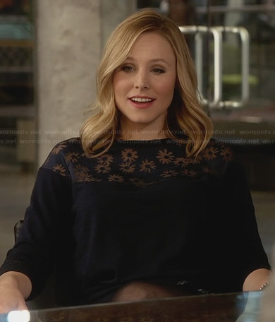 Jeannie's navy sweater with flower insets on House of Lies
