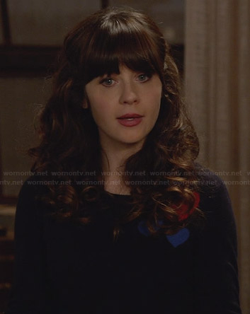Jess's navy sweater with red heart on New Girl