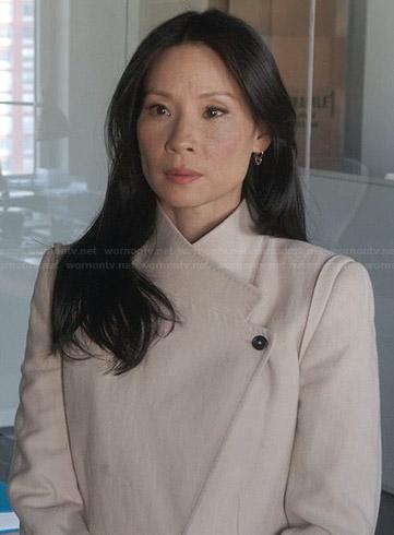 Joan's cream asymmetric coat on Elementary