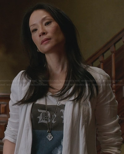 Joan's white and blue graphic tee on Elementary