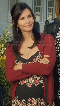 Jules's black floral dress and red pointelle cardigan on Cougar Town
