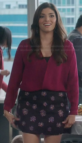 Lauren's red wrap blouse and purple floral skirt on The Crazy Ones
