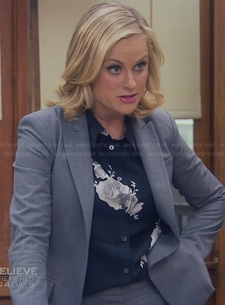 Leslie's black rose printed blouse on Parks & Rec