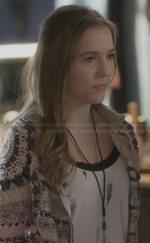 Maddie's crochet jacket and lightning bolt print top on Nashville