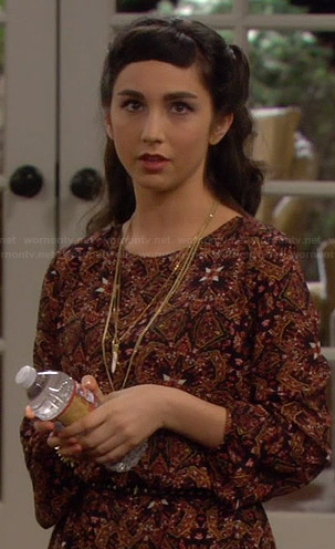 Mandy's orange printed tunic on Last Man Standing