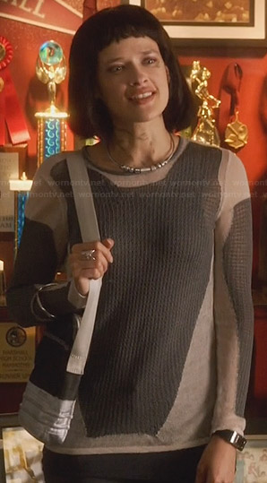 Sophia's grey and white colorblock sweater on Star-Crossed