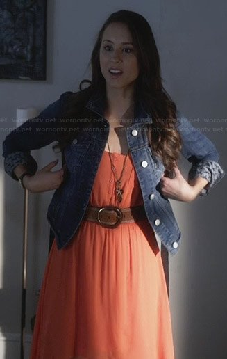 Spencer's orange high-low dress and horse printed denim jacket on Pretty Little Liars