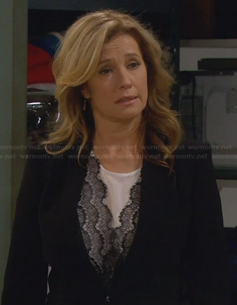 Vanessa's white blouse with black lace front on Last Man Standing