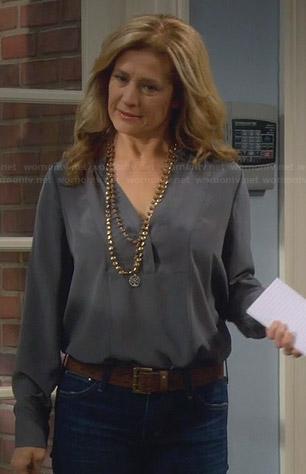 Vanessa's grey split-neck blouse on Last Man Standing