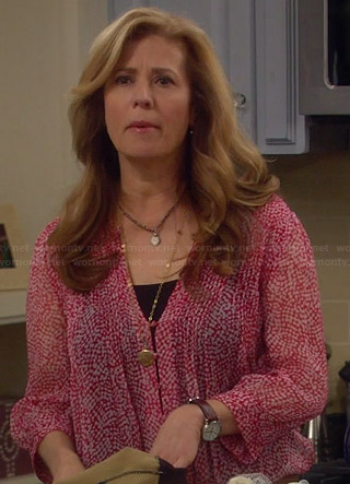 Vanessa's sheer red button front blouse on Last Man Standing