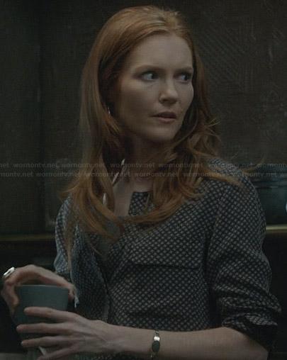 Olivia's white and black textured coat on Scandal