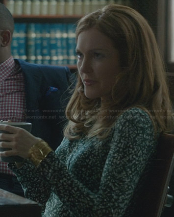 Abby's green and white printed dress on Scandal