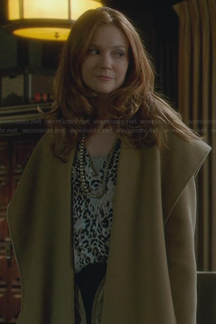 Abby's leopard print blouse and draped coat on Scandal