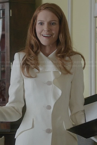Abby's white ruffle coat on Scandal