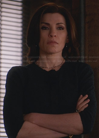 Alicia's navy tweed jacket with black trim on The Good Wife