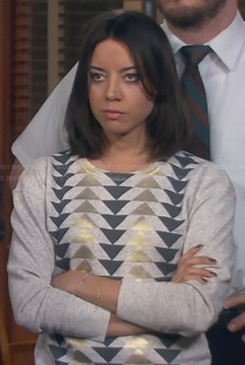 April's grey and gold triangle sweater on Parks and Recreation