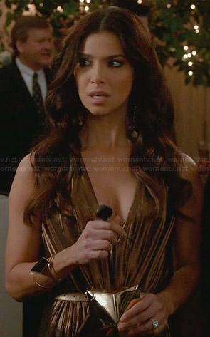Carmen's gold plunge neck gown and star clutch on Devious Maids