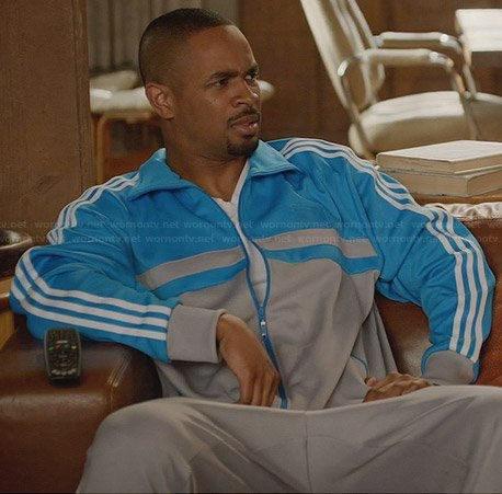 Coach's grey and blue track jacket on New Girl