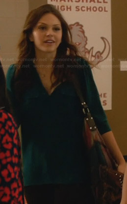 Emery's teal henley shirt on Star-Crossed