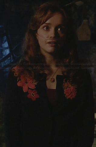 Emma's navy cardigan with orange floral applique on Bates Motel