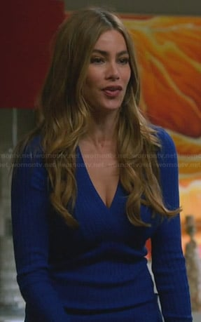 Gloria's blue ribbed surplice sweater on Modern Family