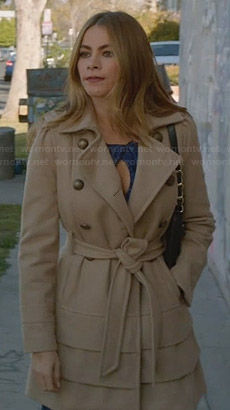Gloria's cream tiered trench coat on Modern Family