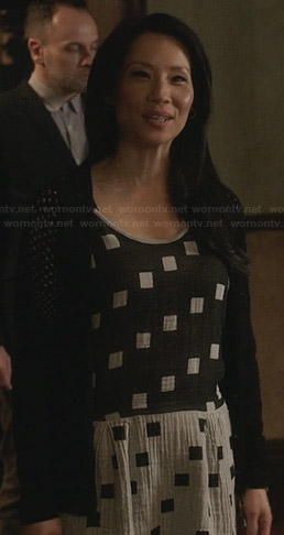 Joan's black and grey square print dress on Elementary