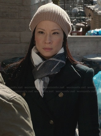 Joan's green plaid coat and beige ribbed beanie on Elementary