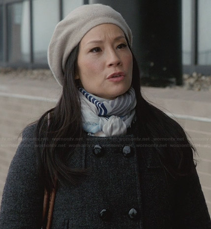 Joan's grey coat and blue striped scarf on Elementary