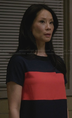 Joan's navy blue and orange colorblock dress on Elementary