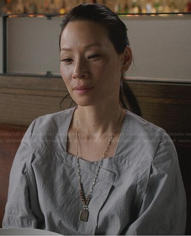 Joan's light grey wide sleeve dress on Elementary