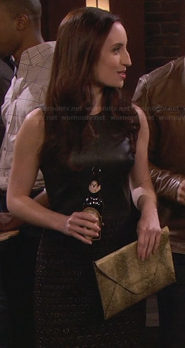Kate's black leather dress with grommet skirt and gold clutch on Friends With Better Lives