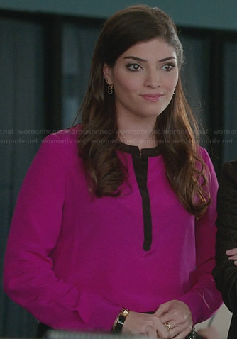 Lauren's pink blouse with black trim on The Crazy Ones
