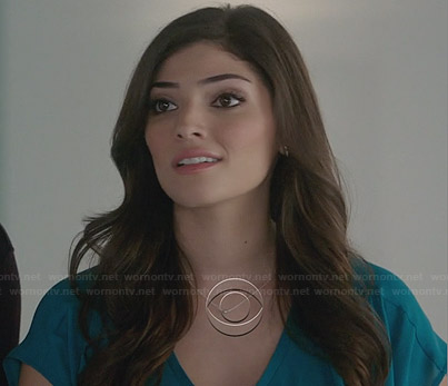 Lauren's teal blue v-neck top on The Crazy Ones