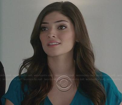 Lauren's teal blue v-neck top on The Crazy Ones