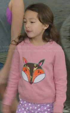 Lily's pink fox sweater and purple polka dot shorts on Modern Family