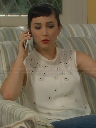 Mandy's white floral embellished top on Last Man Standing