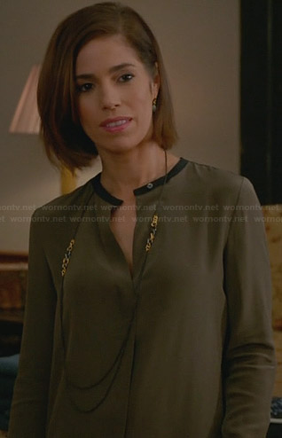 Marisol's army green blouse with black trim on Devious Maids