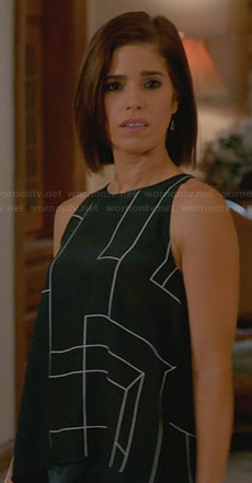 Marisol's black geometric print split-back top on Devious Maids