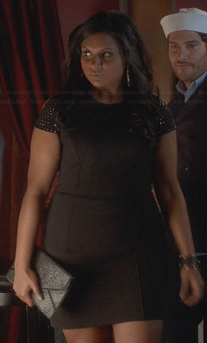 Mindy's black dress with studded cap sleeves and studded clutch on The Mindy Project